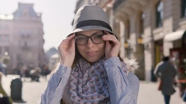 Tourist Girl Putting On Glasses: Stock Video
