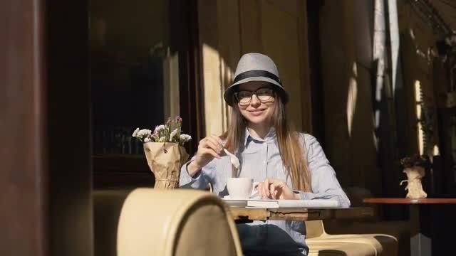 Girl Stirring Coffee In Cafe: Stock Video
