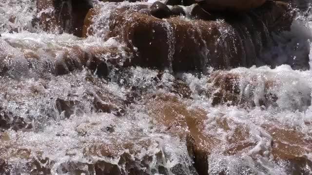 Waterfall On Brown Rocks: Stock Video