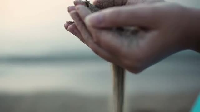 Sea Sand Running Through Hands: Stock Video