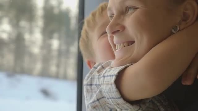 Mother And Son On Train: Stock Video