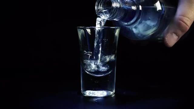 Vodka Poured Into Shot Glass: Stock Video