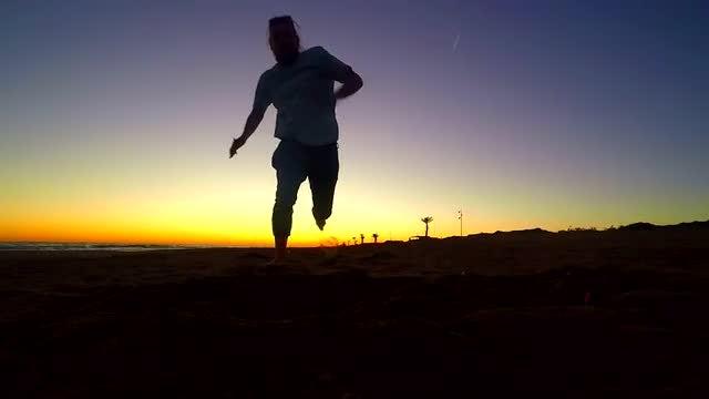 Man Running On The Beach: Stock Video