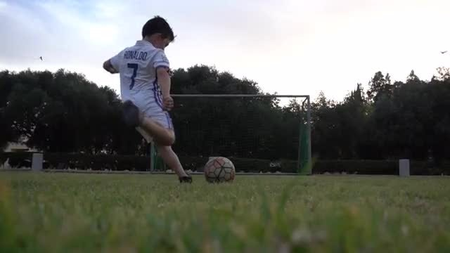 Young Football Player Scores Goal: Stock Video