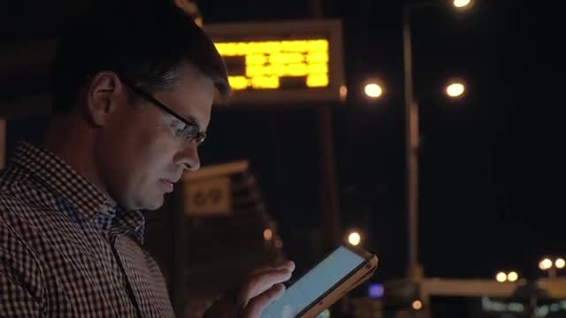Man Using Digital Tablet Outdoors: Stock Video