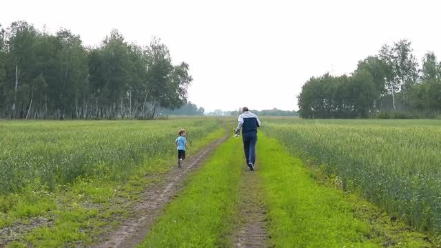 Grandpa And Grandson Running Outdoors: Stock Video