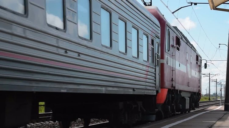 Big Passenger Train Passing By: Stock Video