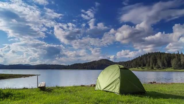 Camping Tent Near Lake: Stock Video