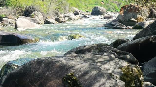 Glacial River Flowing Between Rocks: Stock Video