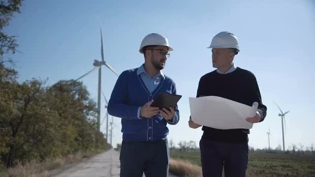 Engineers Discussing Wind Farm Plans : Stock Video