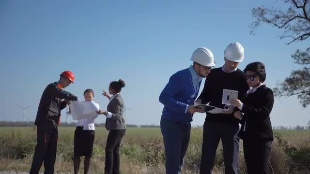 Groups Of Engineers Working Outdoors: Stock Video