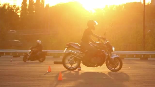 Motorcycle Training Ground At Sunset: Stock Video