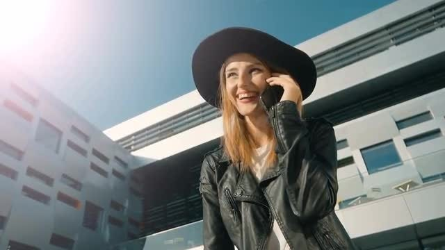 Happy Girl Talking On Phone: Stock Video