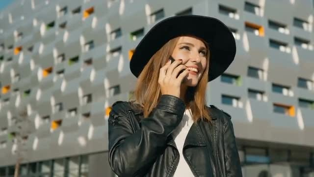 Jovial Girl Talking On Phone: Stock Video
