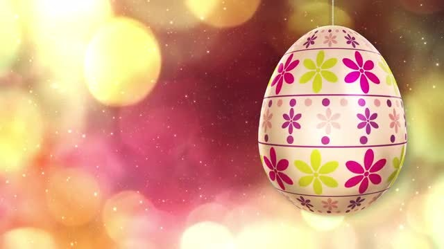 Rotating Easter Egg On Bokeh Background: Stock Motion Graphics