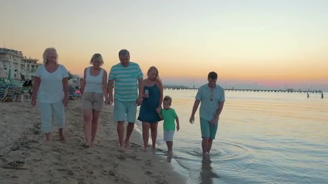 Happy Family Strolling On Beach : Stock Video