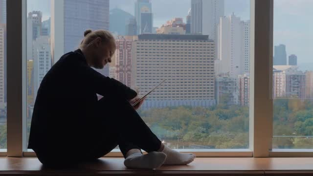 Woman Using Tablet By Windowsill: Stock Video