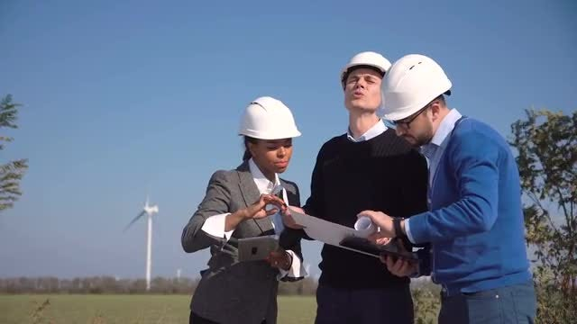 Engineers Discussing Wind Turbines Outdoors : Stock Video