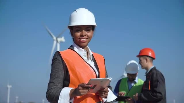 Woman Engineer And Turbine Background: Stock Video