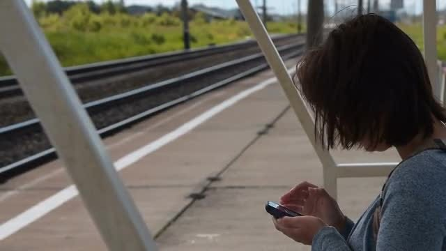 Woman Using Smartphone Outdoors: Stock Video