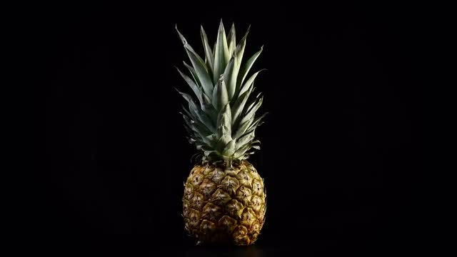 Pineapple Rotating In Slow Motion: Stock Video