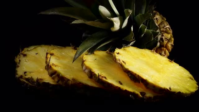 Slices Of Pineapple Rotating Slowly: Stock Video