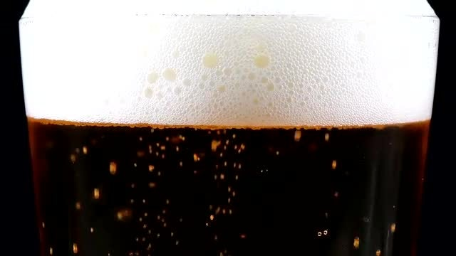 Close-up Of Glass Of Beer: Stock Video
