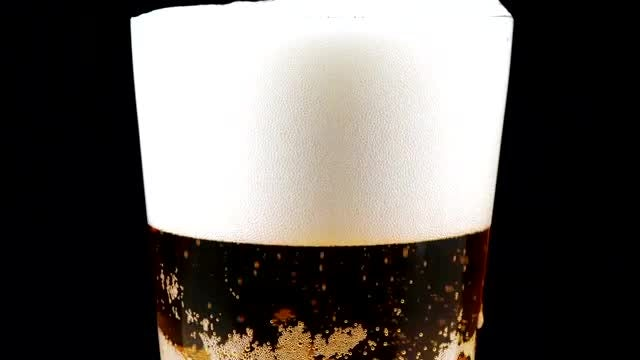 Fresh Beer In Rotating Glass: Stock Video