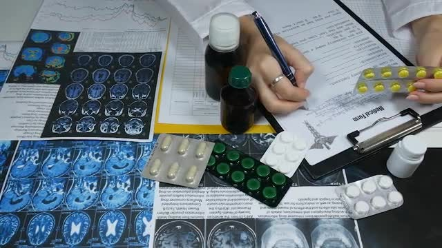 Female Doctor Prescribing Medicine: Stock Video