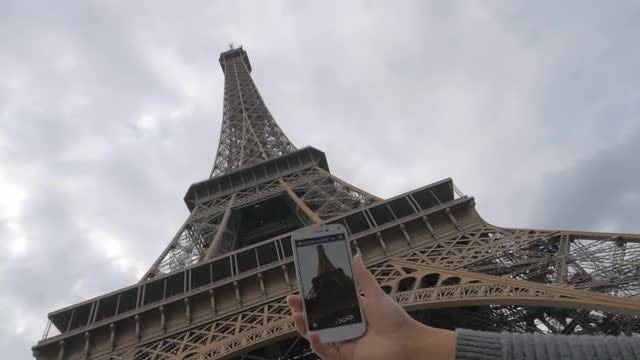 Taking Photo Of Eiffel Tower: Stock Video
