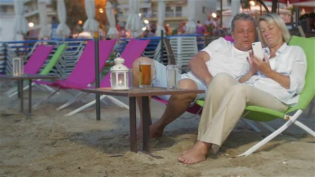 Couple With Smartphone On Holiday: Stock Video
