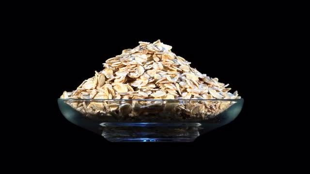 Oatmeal Rotating In Glass Bowl: Stock Video
