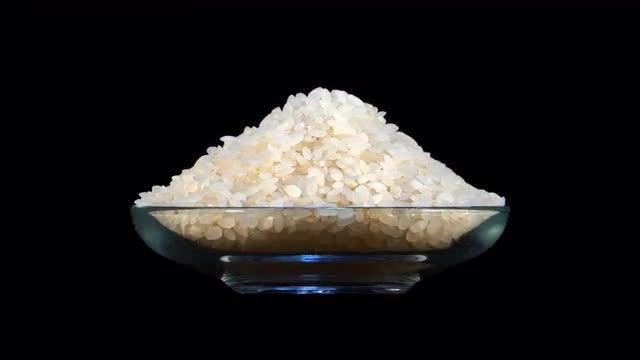 Rice In Rotating Glass Bowl: Stock Video