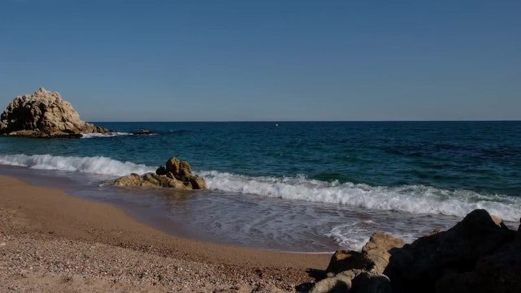 Ocean Waves On Empty Beach: Stock Video
