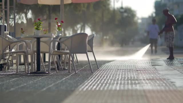 Worker Pressure Washing Street Patio: Stock Video