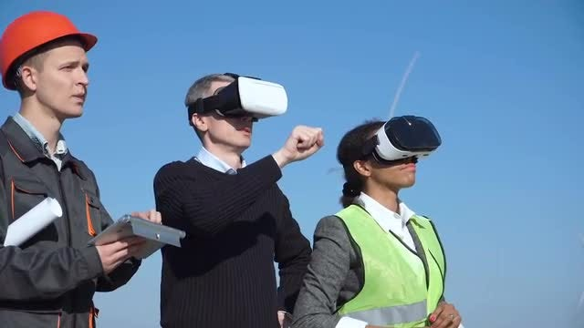 Engineers With Virtual Reality Headset: Stock Video