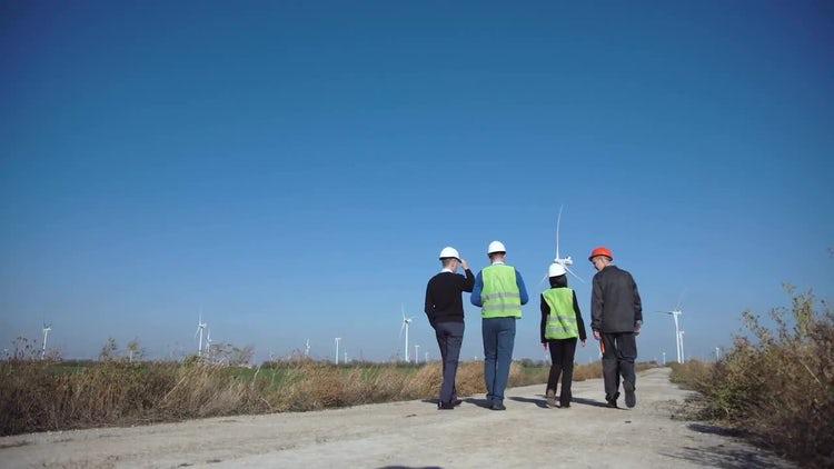 Engineers Walking On Wind Farm: Stock Video