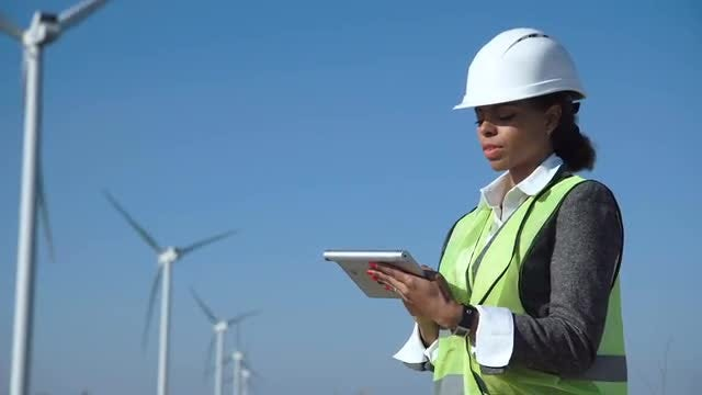 Female Engineer In Wind Farm: Stock Video