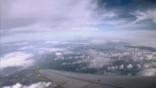Cloudscape From Inside The Plane: Stock Video