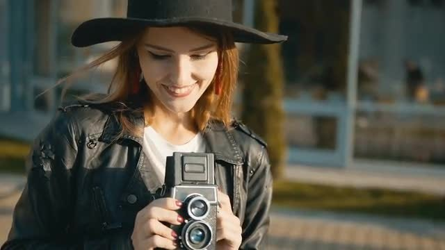Tourist Girl With Vintage Camera: Stock Video