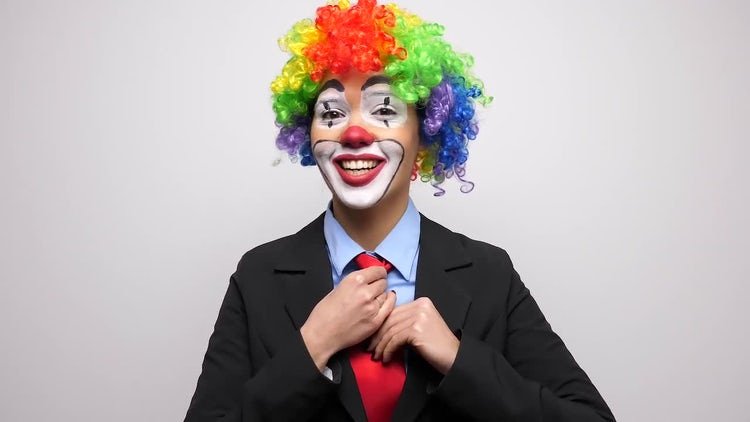 Woman Clown Adjusting Her Tie: Stock Video