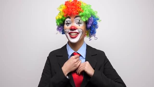 Woman Clown Adjusting Her Tie: Stock Video