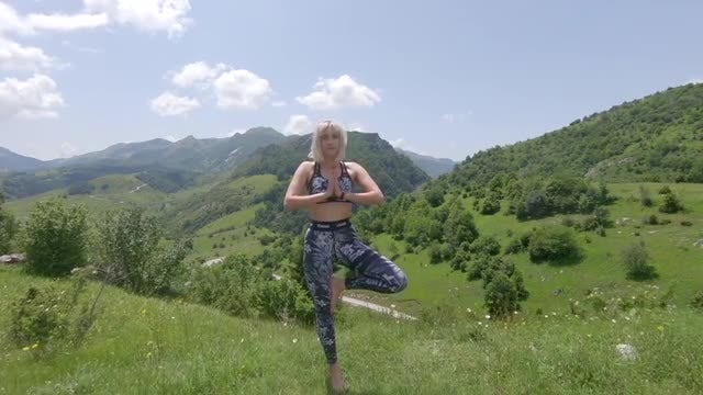 Woman Doing Yoga: Stock Video