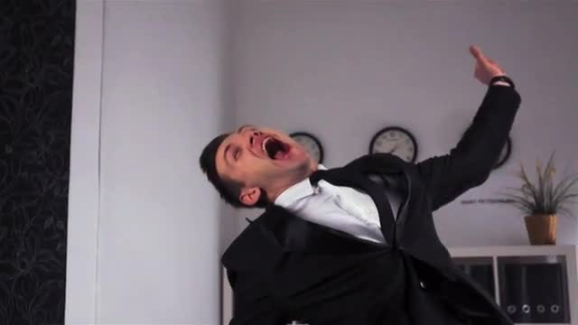 Businessman Celebrates In Office: Stock Video