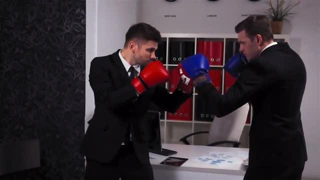 Two Businessmen Boxing In Office : Stock Video