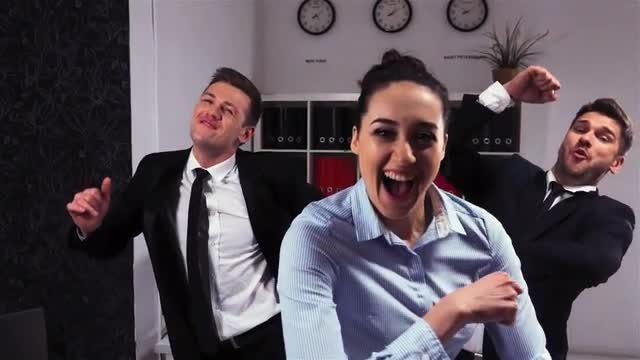 Happy Businessmen And Woman Dancing: Stock Video
