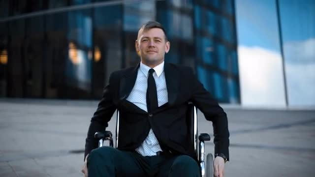 Impaired Happy Businessman In Wheelchair : Stock Video