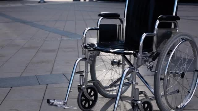 Empty Wheelchair Rolling : Stock Video