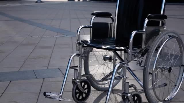 Empty Wheelchair Rolling : Stock Video