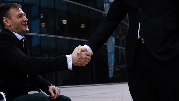 Disabled Businessman Exchanging Handshake: Stock Video